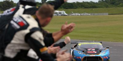 British GT- Crowd cheers and waves as Lamboghini approaches them on the track