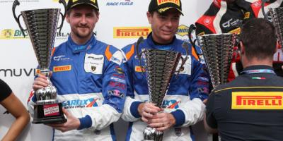 British GT Drivers holding trophies on the podium