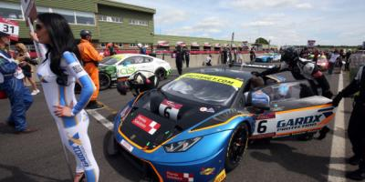 British GT- racing drivers and team are getting the car ready to start the race