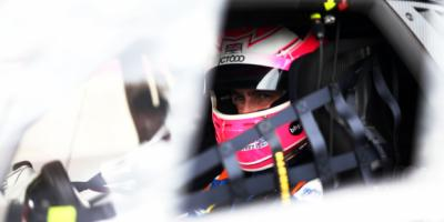 British GT Racing Driver sitting in his car
