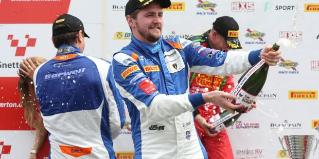 British GT- Racing Driver Sam Tordoff opens bottle of champagne